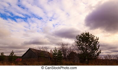 Clouds sweep over the barn. Time Lapse