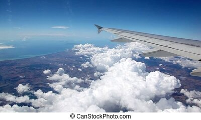 Clouds under aircraft wing