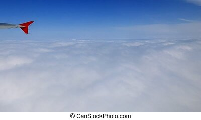 Clouds under the wing of the aircraft