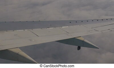 Clouds under the wing of the aircraft.