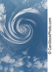 In the sky clouds circling around each other and form a vortex.