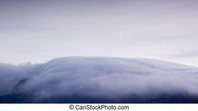 clouds waterfall hide the mountain peak