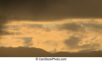 Clouds with Soft Sunlight - Steady, wide shot of layers of...