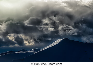 Clouds with spectacular colors in a mountain landscape
