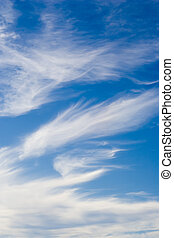 Cloudscape - Azure blue sky with whispy white clouds.