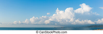Cloudscape horizontal banner or panorama of beautiful fluffy...