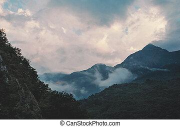 Cloudscape over mountain ridge.