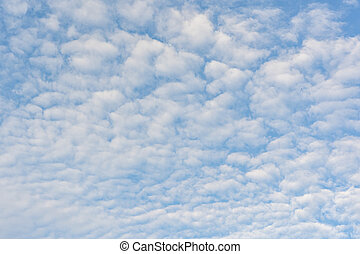 Cloudscape photo of white clouds on blue sky