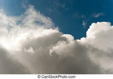 Cloudscape - Rain clouds parting after a long rainstorm.