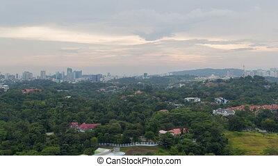 Cloudscape sunset time-lapse of Kuala Lumpur city. pan up