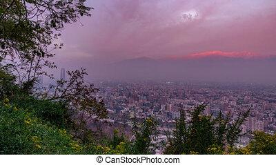 Cloudscape time lapse at dusk over Santiago de Chile city roofs