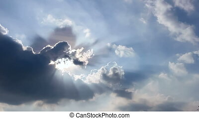 cloudscape with bright sun shining with clouds passing.