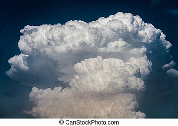 Cloudscape with very big cumulonimbus clouds shot with a long tele