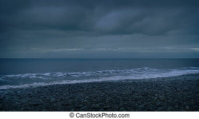Cloudy Beach Shore In The Evening - Rocky beach shore at...