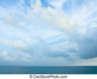 Cloudy blue sky and turquoise ocean
