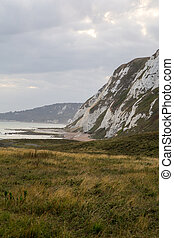 View of the White Cliffs of Dover on a cloudy day.