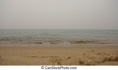 Cloudy day on the Empty Sea Ocean beach sand and sea waves....