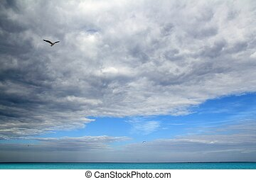 Cloudy dramatic sky in caribbean turquoise sea