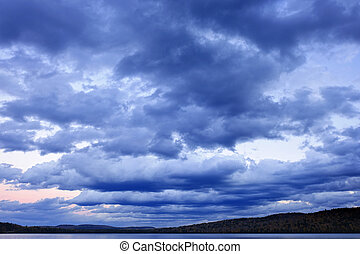 Cloudy dramatic sky - Blue cloudy dramatic sky at sunset...