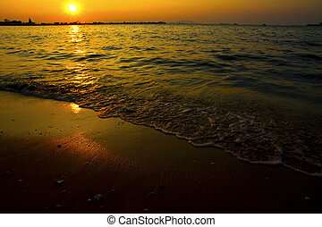 Cloudy orange sunset over sea