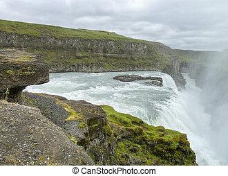 Gullfoss - cloudy scenery including the Gullfoss waterfall...