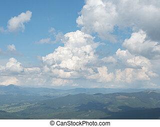 Cloudy sky above the mountain range. Carpathians mountains...