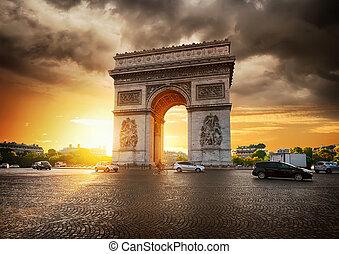 Cloudy sky and Arc de Triomphe