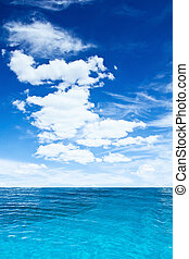 Cloudy sky and ocean. Tropical vertical composition
