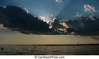 Cloudy sky at sunset sea