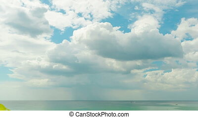 Cloudy sky - Clouds passing through the sky above the sea....