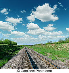 cloudy sky over railroad