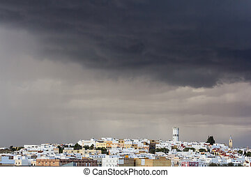 Cloudy sky over village