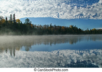 Cloudy Sky Reflecting on an Autumn Lake