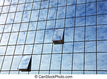 Cloudy sky reflection in business building glass
