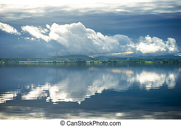 Cloudy sky with reflection