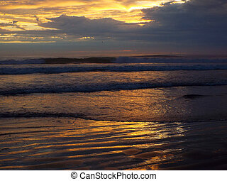 Cloudy Sunset Over the Ocean with Waves in the Foreground
