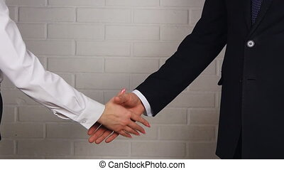 Clouse-up of businessman and  businesswoman shaking hands