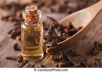 clove oil macro on an old desk. Horizontal - clove oil in a ...