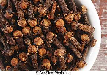 Clove (spice) - cloves on wooden background