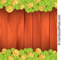 Clovers and golden coins on brown wooden background for St. Patrick's Day