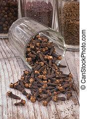 Cloves (Eugenia caryophyllata) - spice cloves on wood...