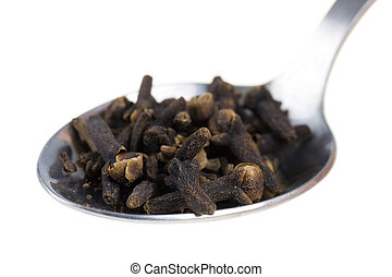 cloves on a spoon isolated on white background