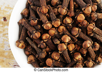 cloves on wooden background