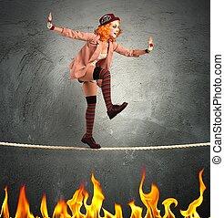Clown balance on fire - Clown balancing on a rope over fire