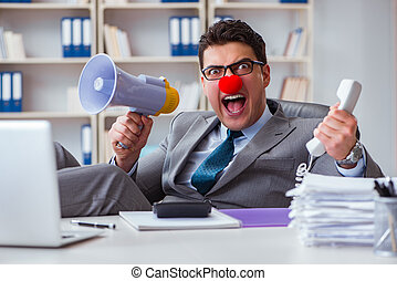 Clown businessman angry in the office with a megaphone