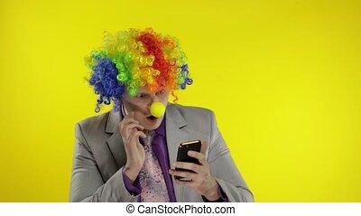 Clown businessman entrepreneur boss in wig losing at work, ...