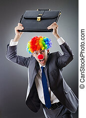 Clown businessman in funny business concept