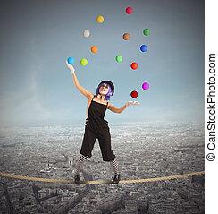 Clown difficult balance - Clown as juggler is balancing on...