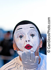 Clown entertain the crowds at a street festival in Venice, Italy