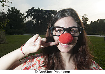 clown girl with red nose at the park